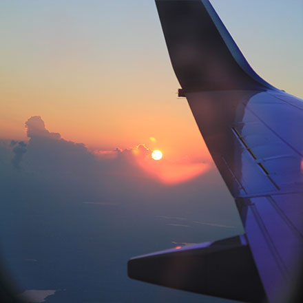 Sunset out of plane window