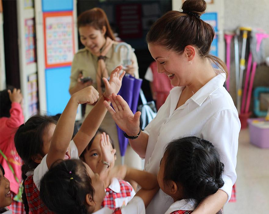 Teacher high-fiving students