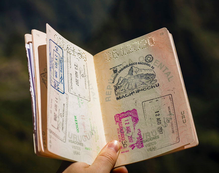 Passport open on page with Machu Picchu stamp
