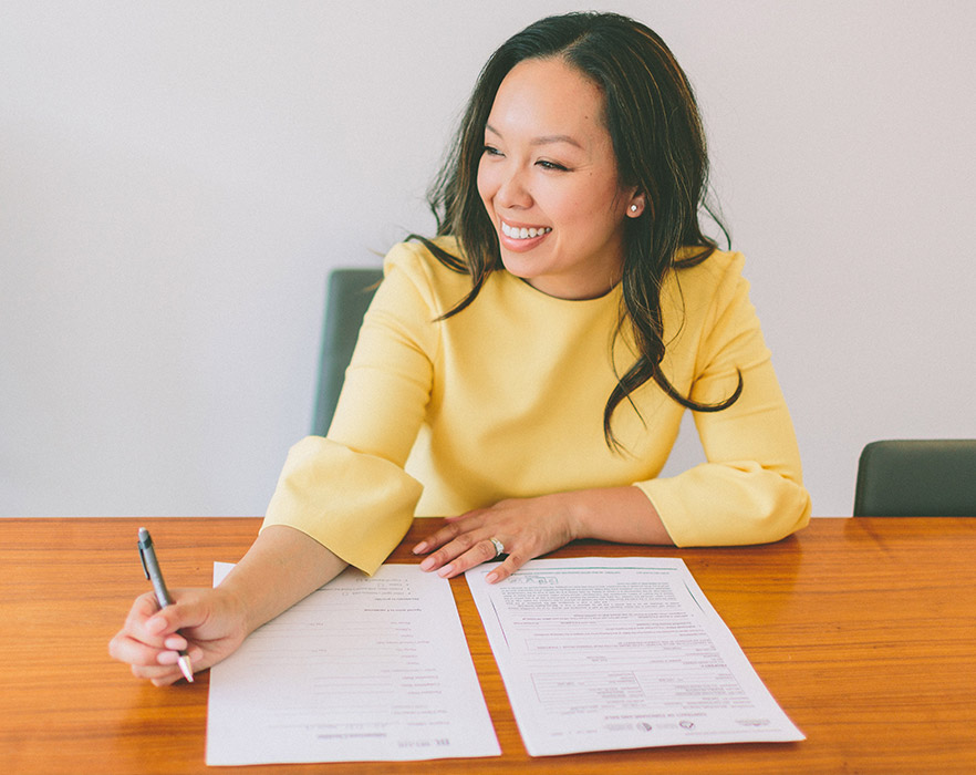 Woman writing TEFL CV