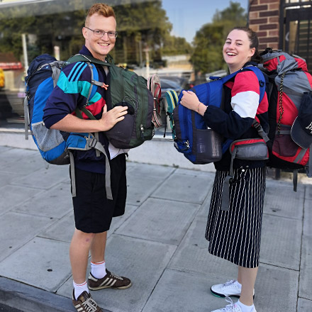 Mitch and girlfriend with backpacks