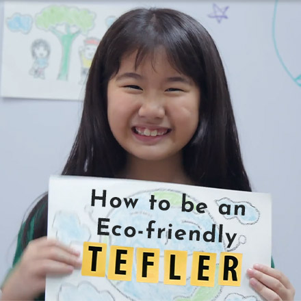 Young girl holding eco-friendly poster