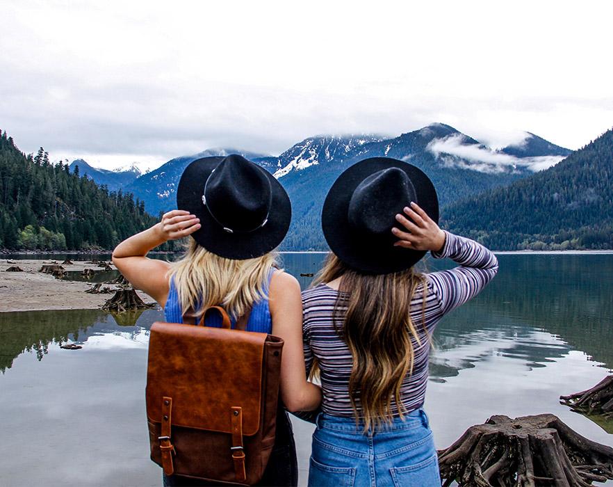 Friends in front of mountain scene