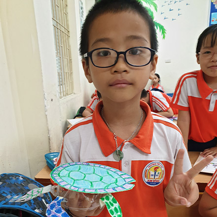 Vietnamese student with Turtle made from recycled bottles