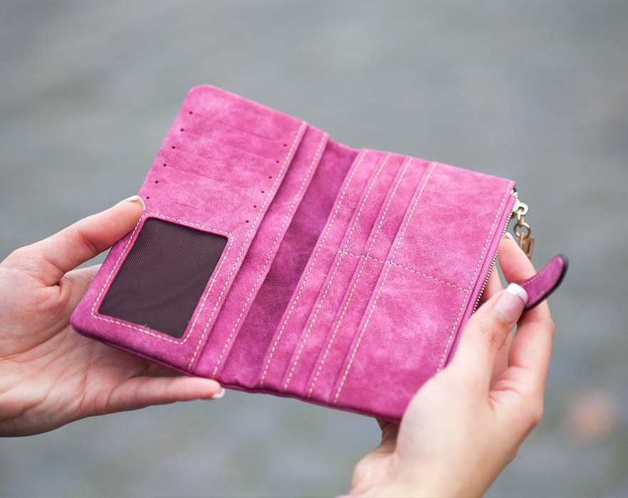 Woman holding empty wallet