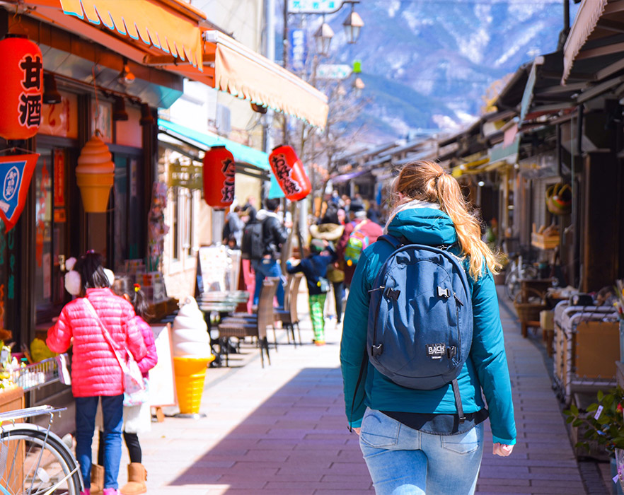 Woman with backpack on exploring TEFL country