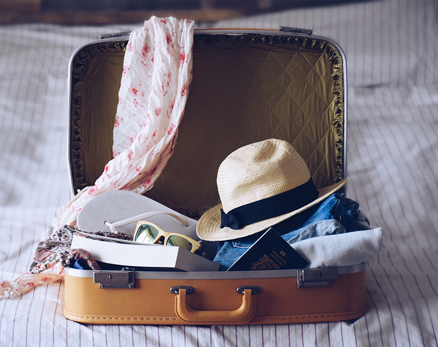 Suitcase open on bed