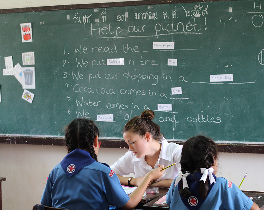 TEFL teacher with 2 students in classroom