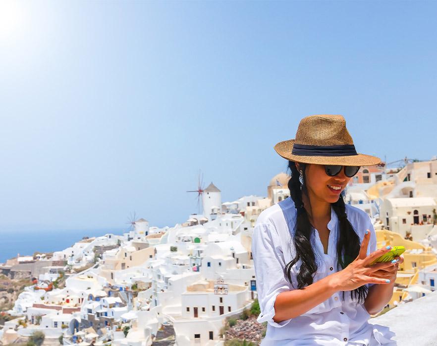 Woman tourist using phone in Greece
