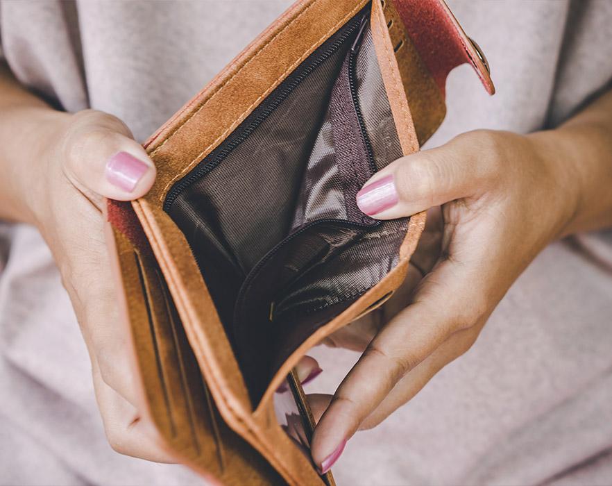 Woman holding open empty wallet