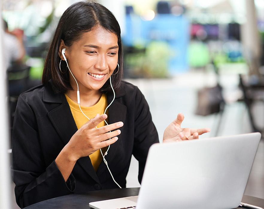 Woman teaching English online with headphones