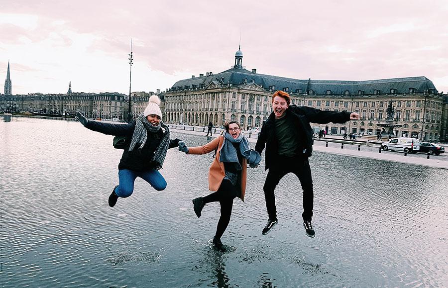 TEFL teachers jumping outside a european monument