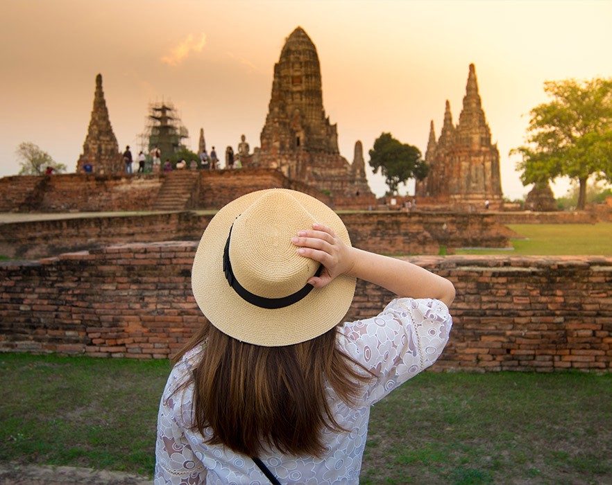 Woman in front of temple, Cambodia