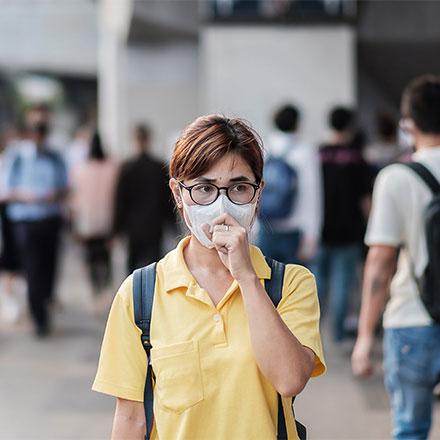 Woman wearing protective mask, China