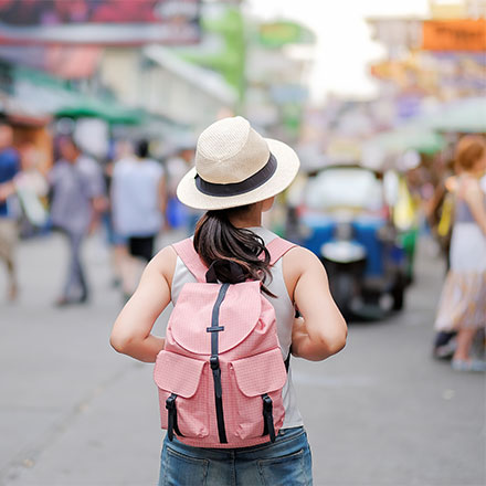 Woman with backpack on walking through streets