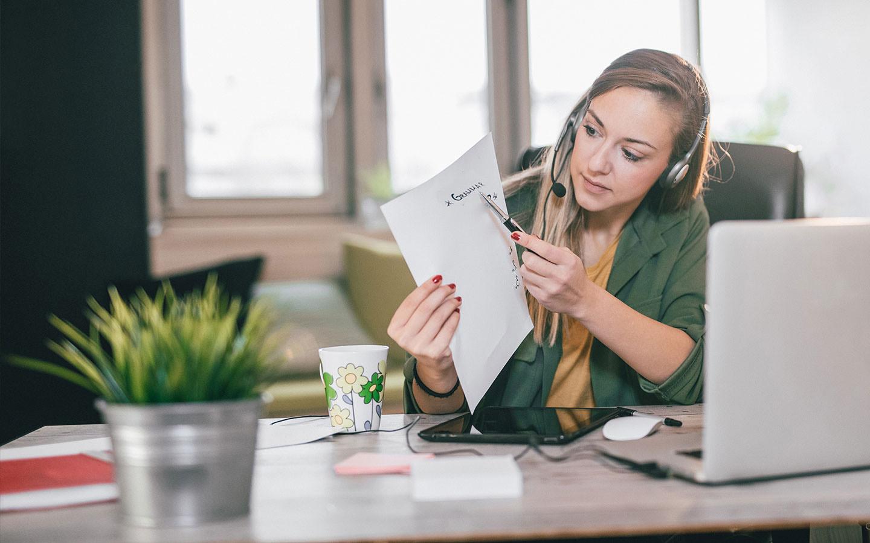 Woman teaching online using laptop