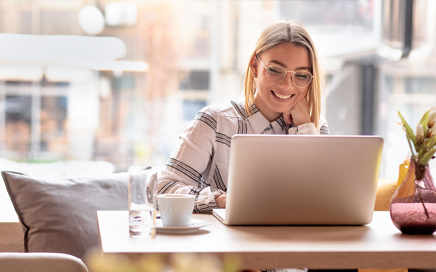 Girl teaching online on her laptop and smiling