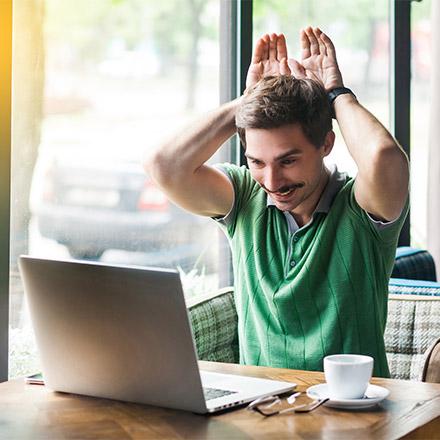 Man using laptop to teach English online