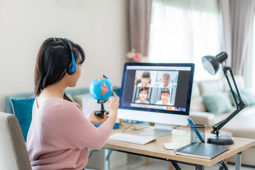 woman teaching group class on laptop