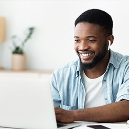 Man using laptop to teach English online