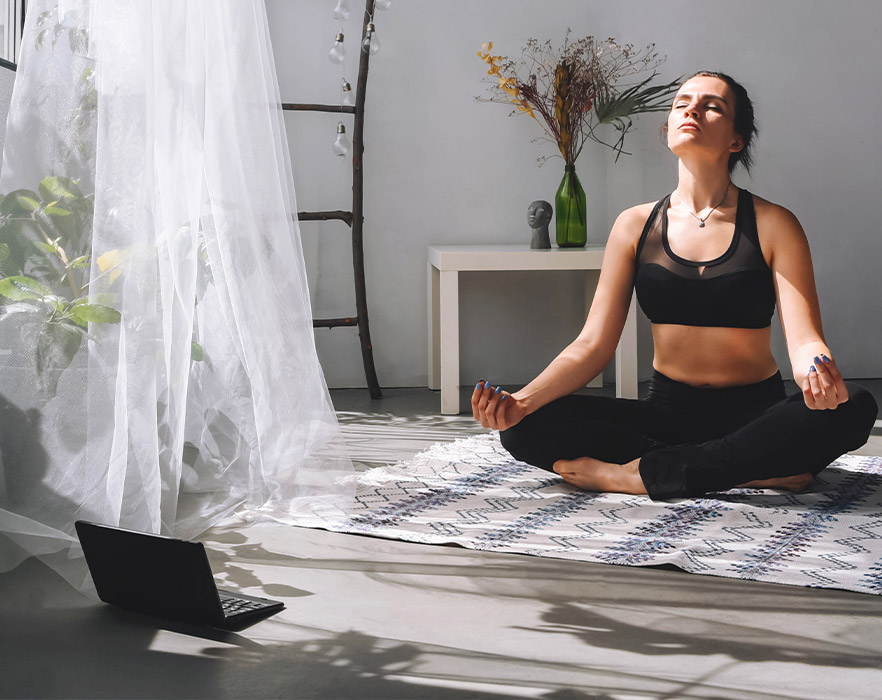 Woman learning yoga online