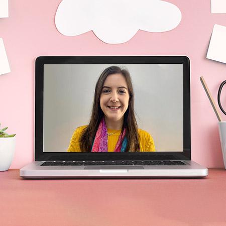Laptop on desk with image of online TEFL tutor, Catherine