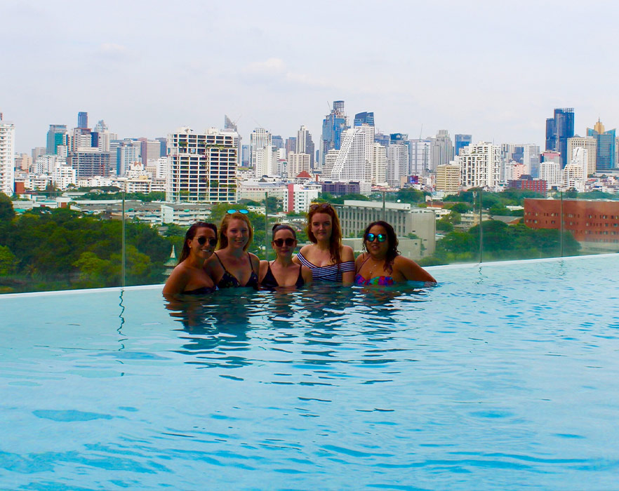 Friends in infinity pool, Thailand
