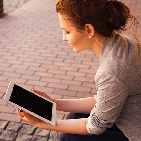 Woman using iPad tablet