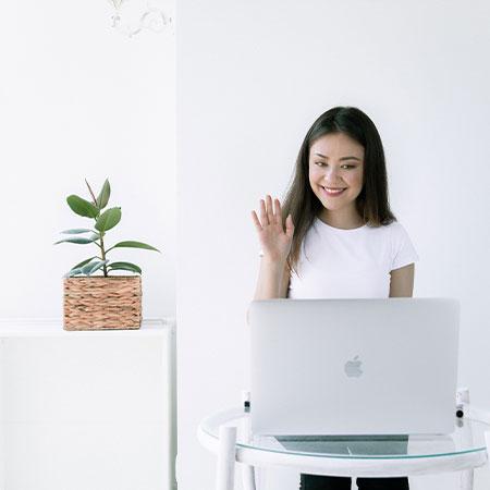 girl using laptop to teach English online
