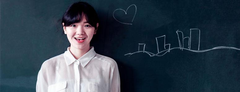 tefl teacher standing next to a blackboard