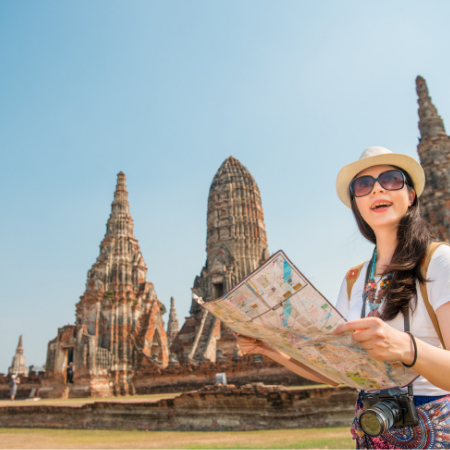 Woman exploring temples with a map