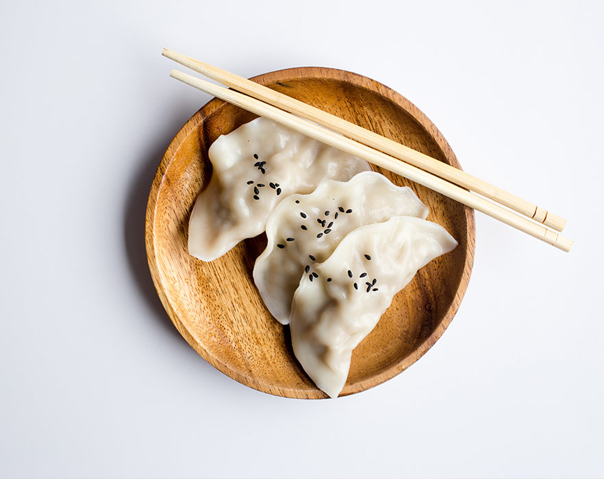 chinese dumplings and chopsticks