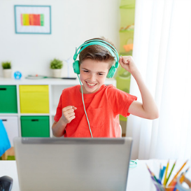 http://young%20boy%20using%20headset%20to%20hear%20tefl%20lesson