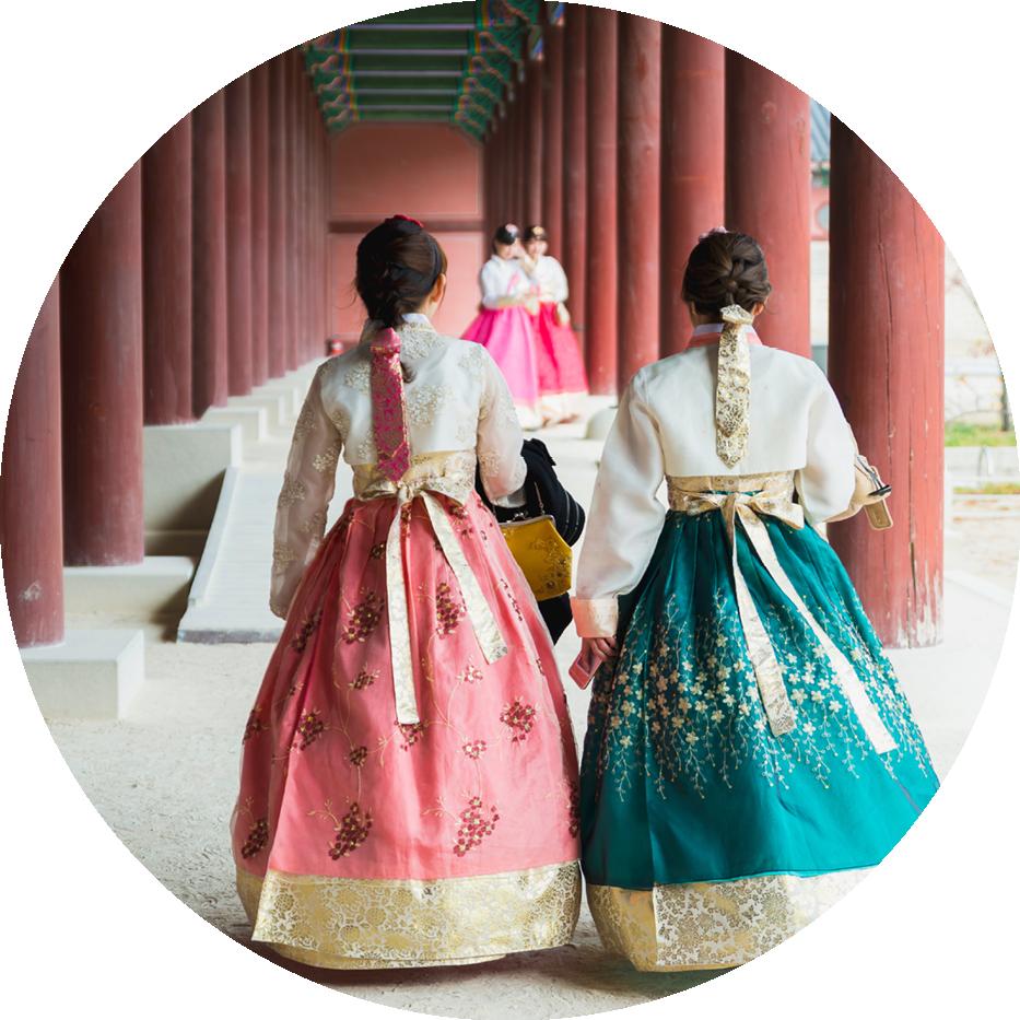 two south korean women in dresses