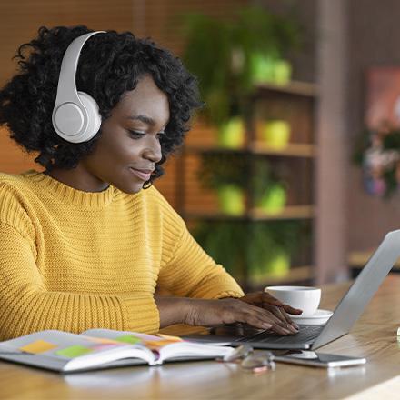 Woman sat at laptop
