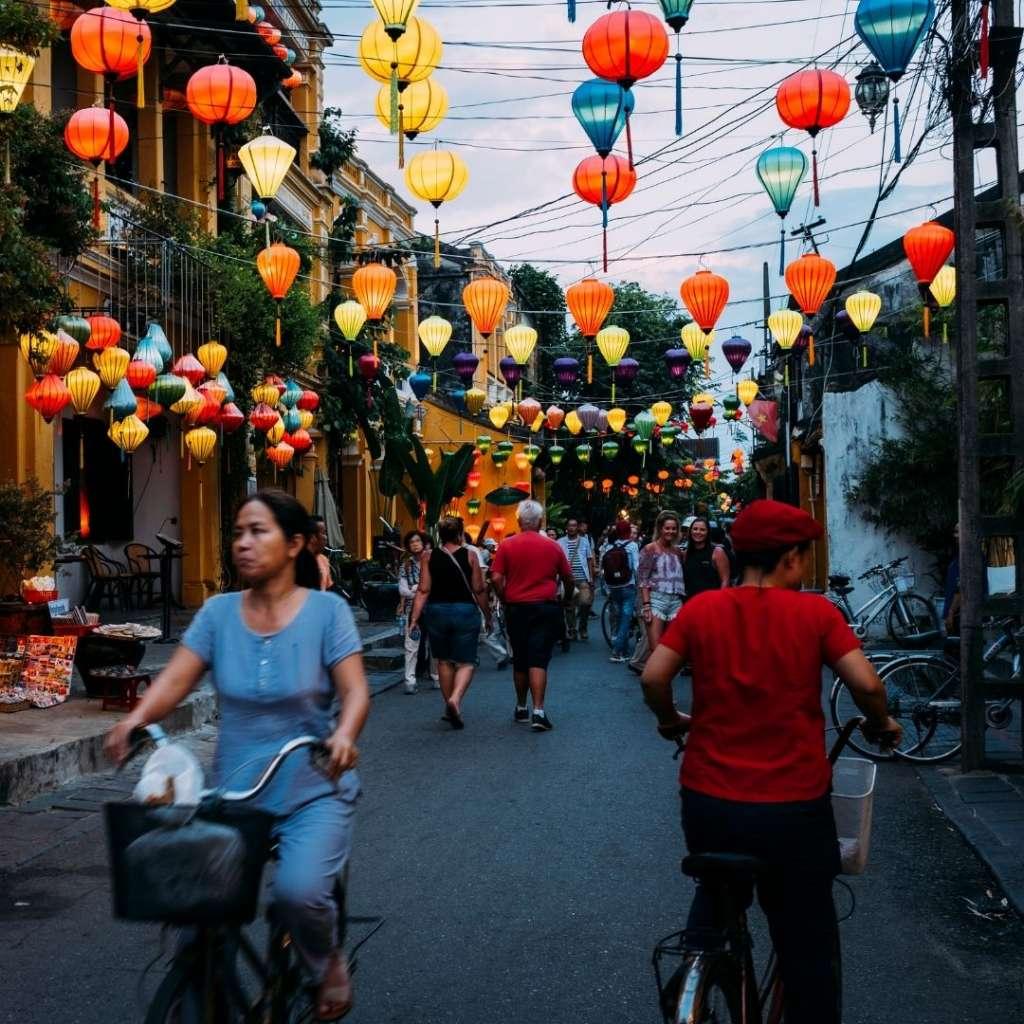 people walking through the streets in Vietnam